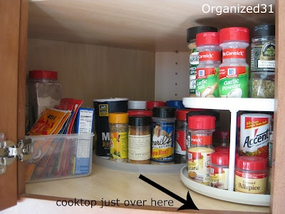 open cabinet with organized spices on turn tables