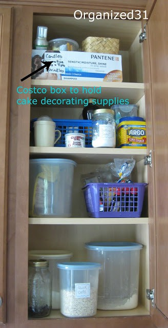 kitchen cupboard with box organizing items and arrow pointing to it