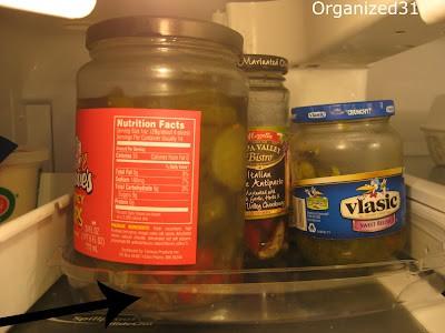 glass jars on refrigerator shelf
