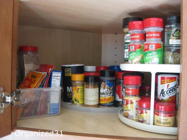 spices organized in corner kitchen cabinet
