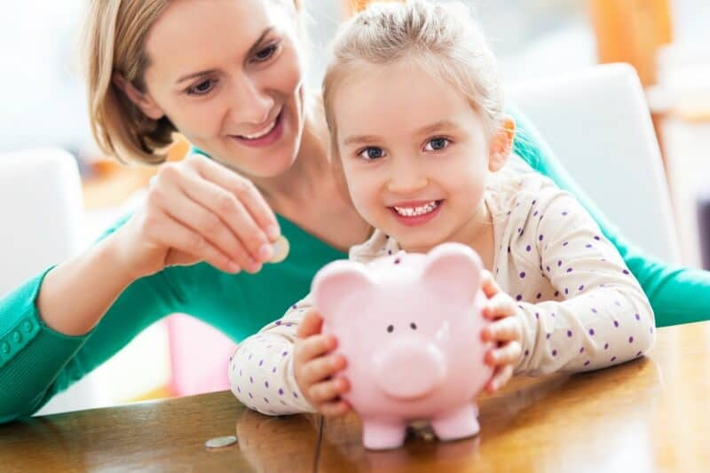 Mother and child with piggybank