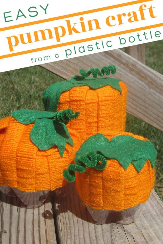 3 crafted yarn pumpkins in different sizes on wood table