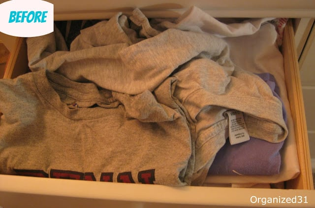 messy pile of t-shirts in a drawer