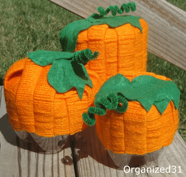 3 yarn pumpkins on wood table