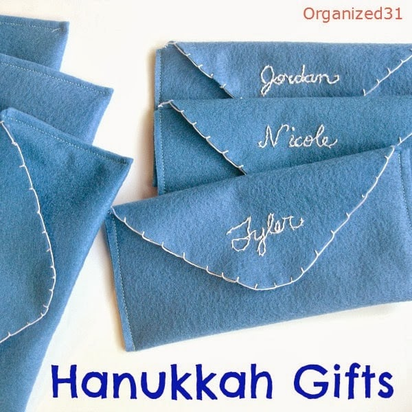 close up of DIY blue felt gift envelopes with title text reading Hanukkah Gifts