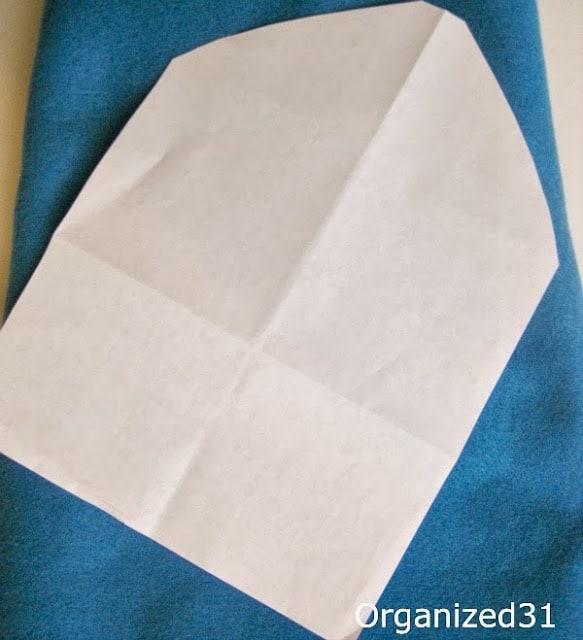 paper envelope pattern on top of blue felt