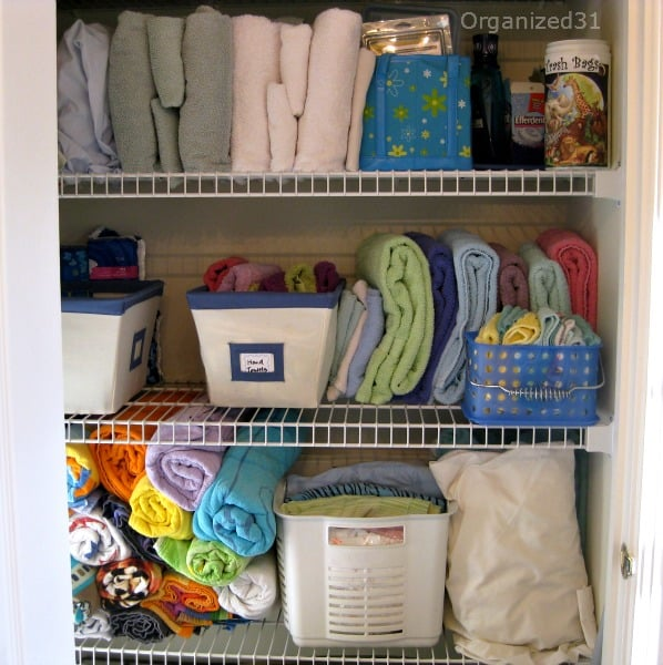 organized shelves of linen closet
