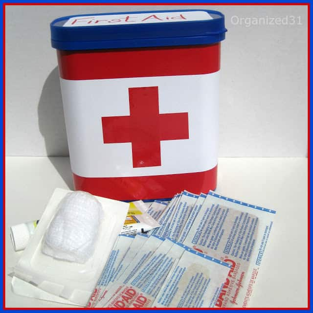 Organized 31 - Repurposed plastic breakfast container to First Aid Kit