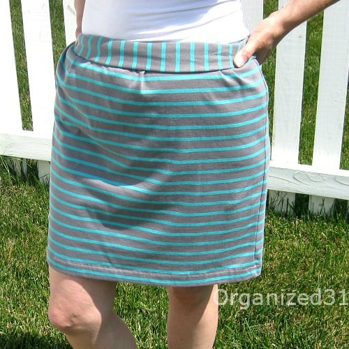 close up of woman wearing green and blue knit skirt
