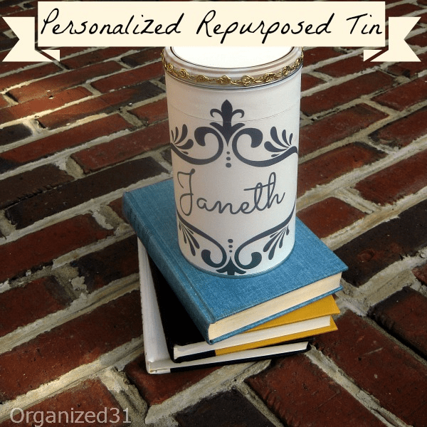 decorated metal can on top of stack of books on bricks