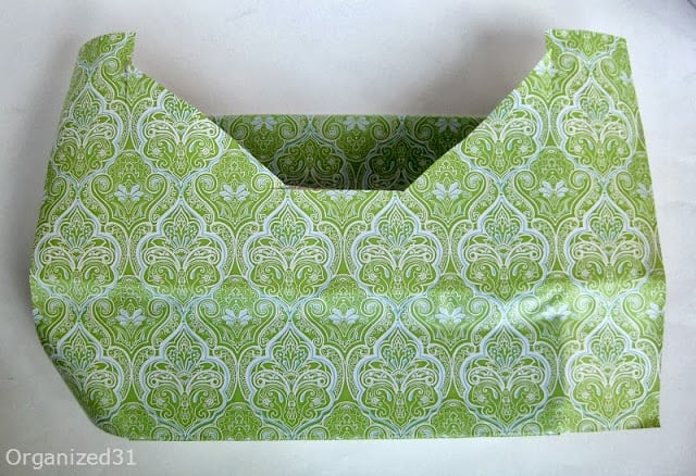 box being covered with green and blue adhesive paper