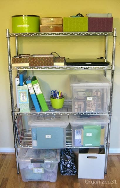 metals shelf unit with plastic crates, binders and boxes