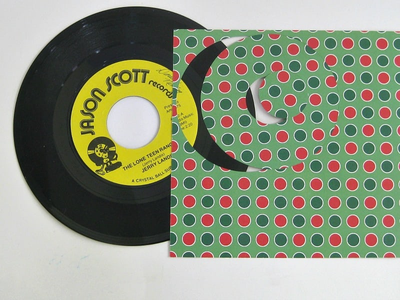 45 record with Christmas paper with ring cut out to cover record label