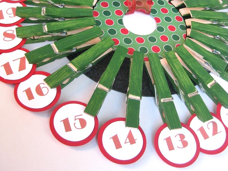 Close up of clothes pins holding dates on Advent calendar