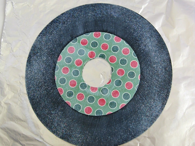 45 record with label covered with Christmas-themed paper