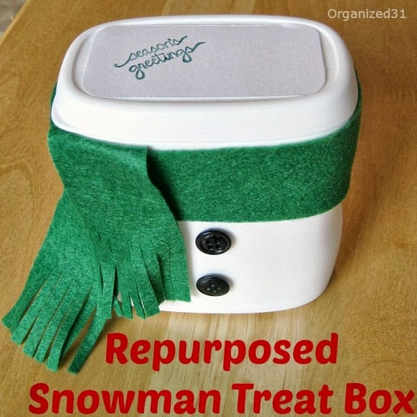 white plastic food container decorated to look like a snowman
