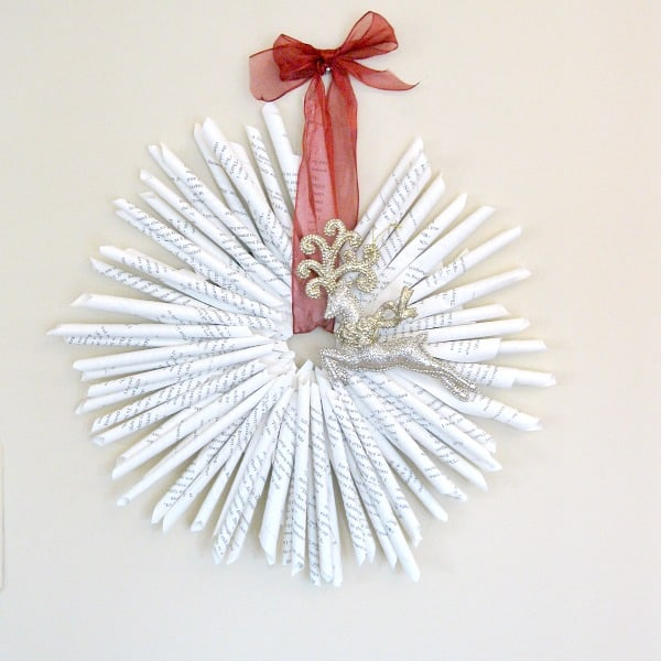 Upcycled Book Page Wreath hung with red bow