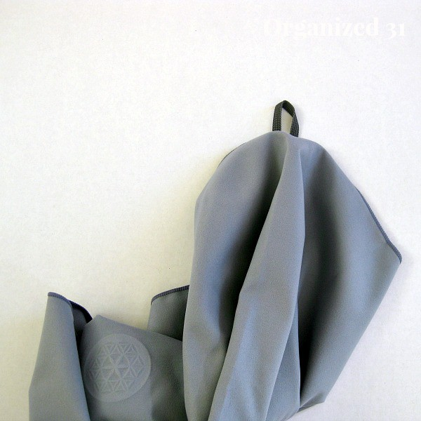 grey towel with black loop on edge