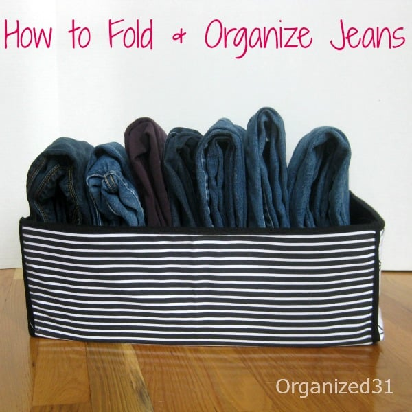 folded jeans in striped bin with title text reading How to Fold & Organize Jeans