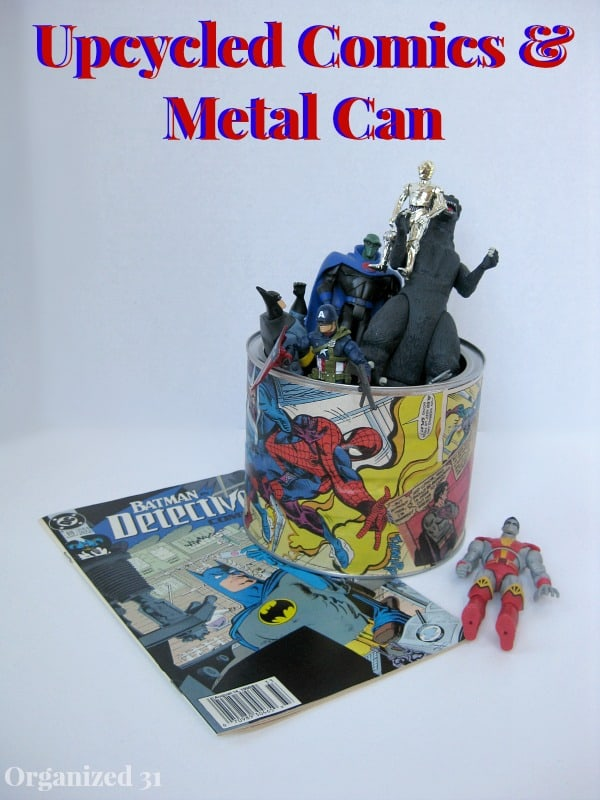 large can decorated with comic book pages, can is filled with superhero figures and comic book laying on table