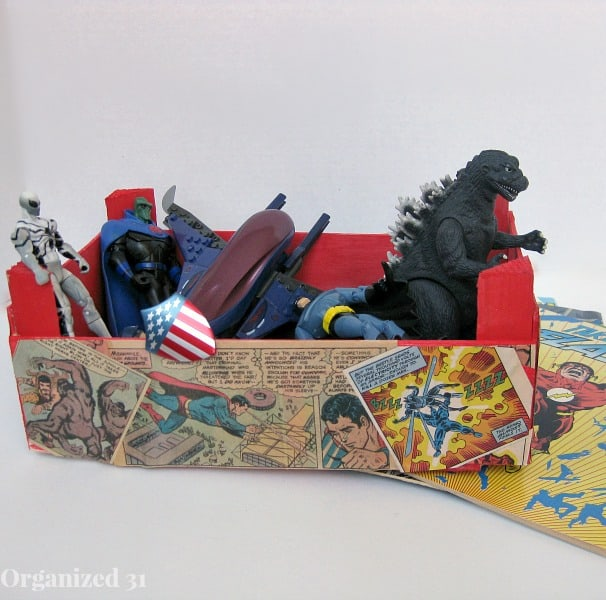 toys in comic book decorated box