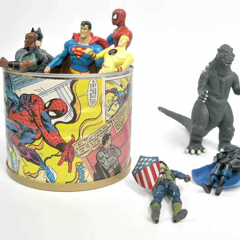 metal can decorated with comic book pages and superhero figures