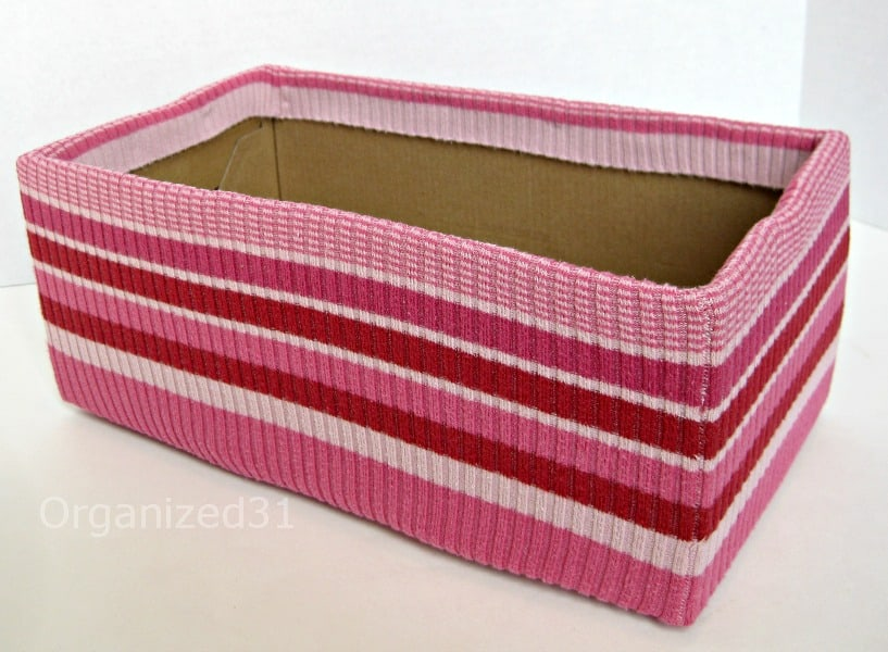 pink striped sweater covered box