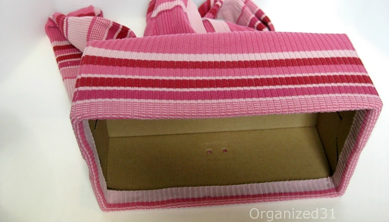 You want the finished hem of the sweater to fold into the inside edge of the box so it will hold up and not fray.