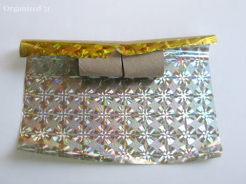 recycled toilet paper roll on gold and silver foil paper