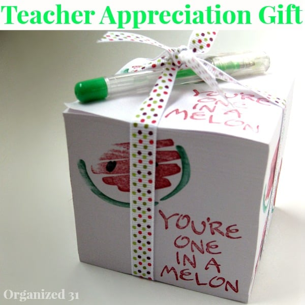 "note cube with ""You're one in a melon"" stamped on side with ribbon and pen"