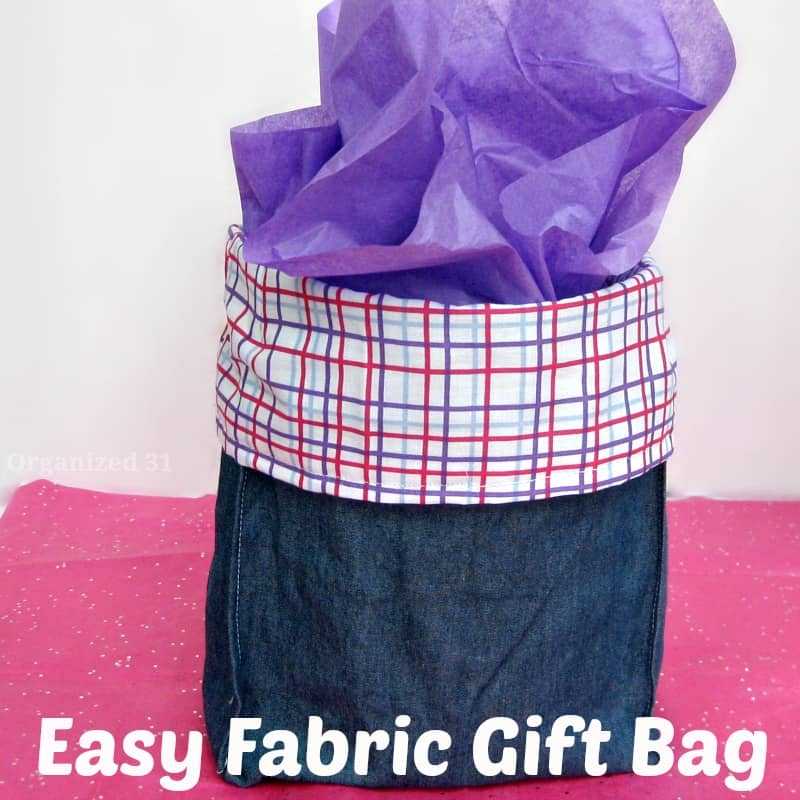 diy blue fabric gift bag with purple tissue paper