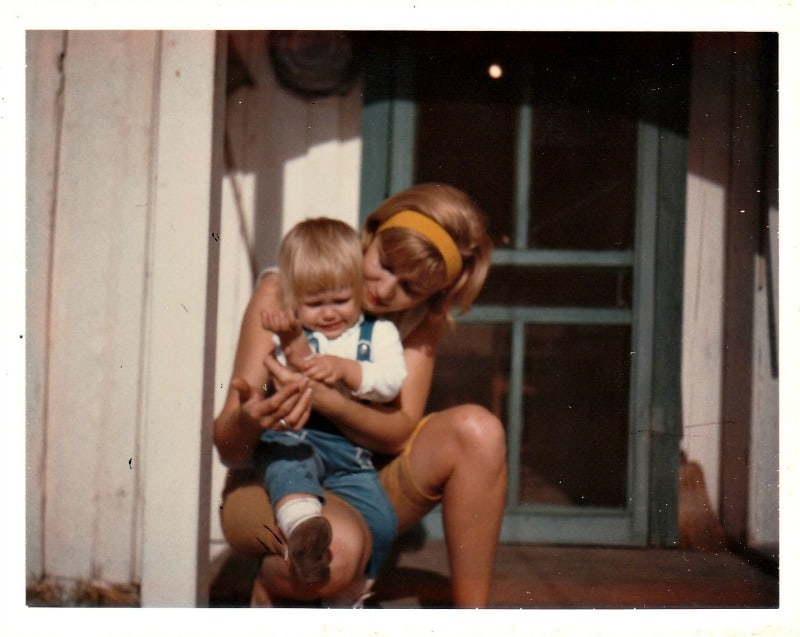 vintage photo of mother holding and comforting young crying girl