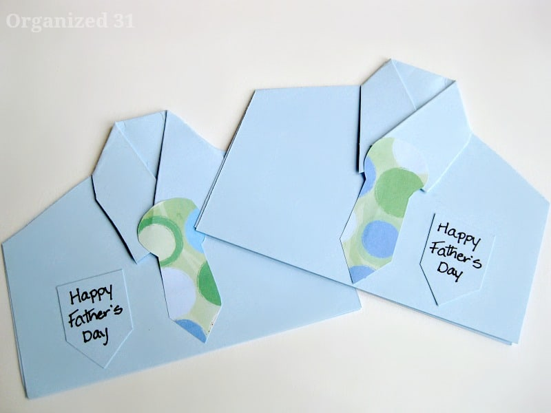 2 cards that look like blue shirts with ties