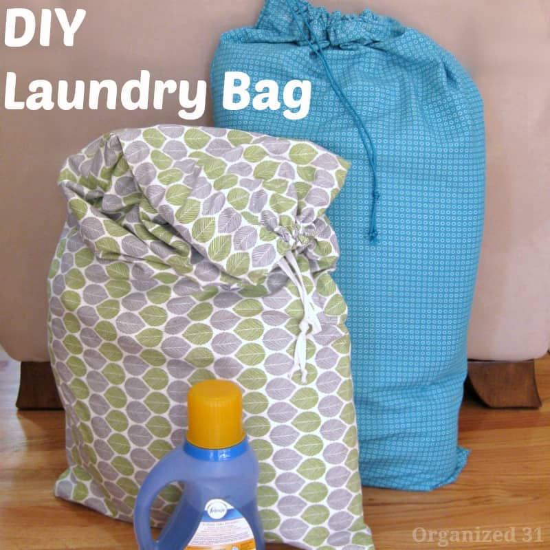 2 filled laundry bags with bottle of detergent