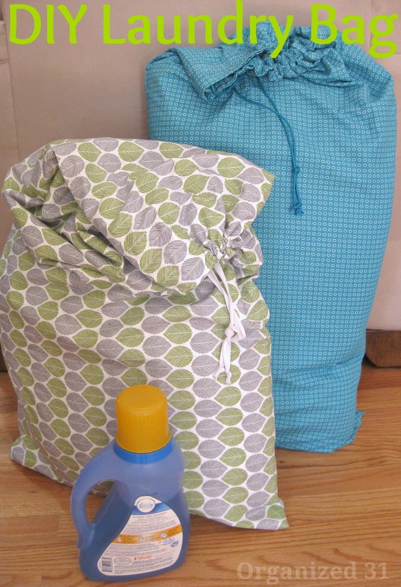 2 full fabric laundry bags and bottle of laundry detergent