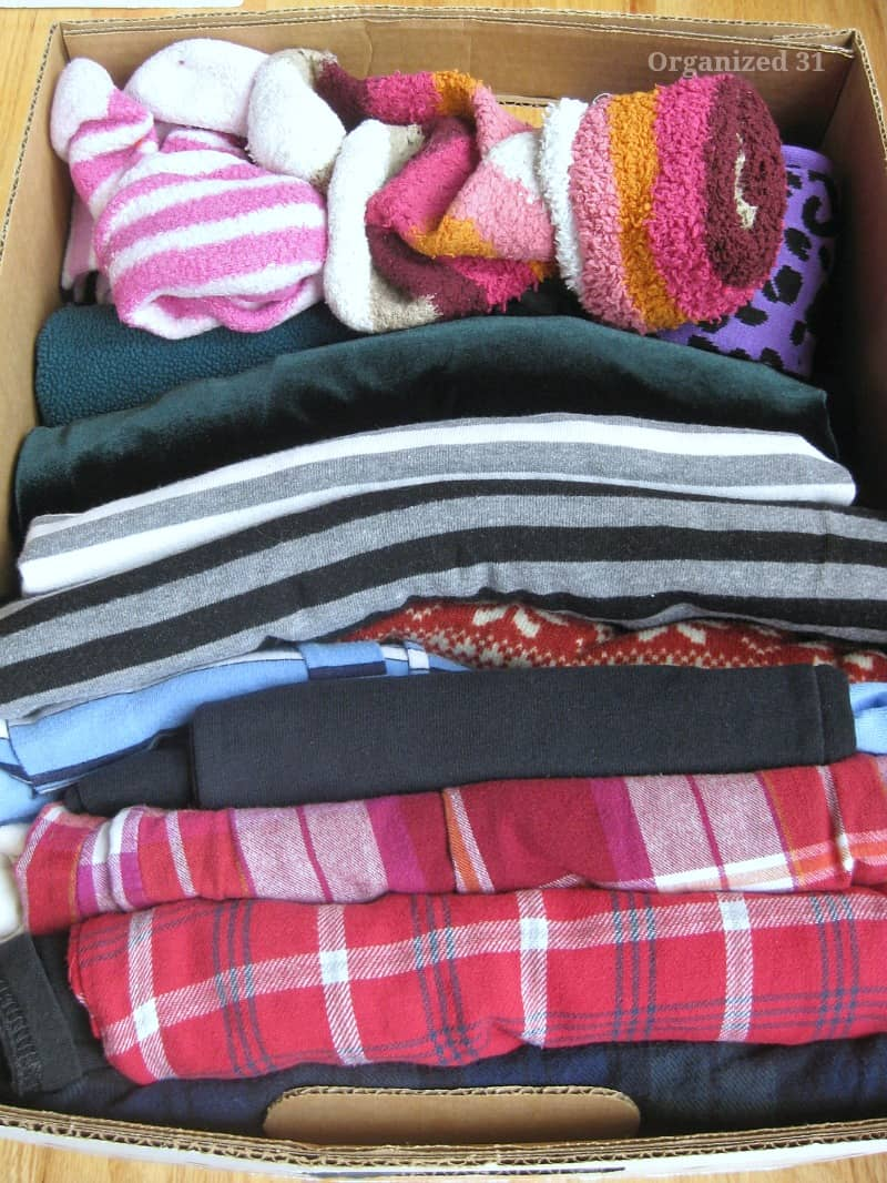 Close up of clothes and socks neatly folded in box