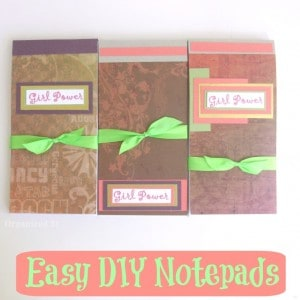 decorated  note pads tied with green ribbon