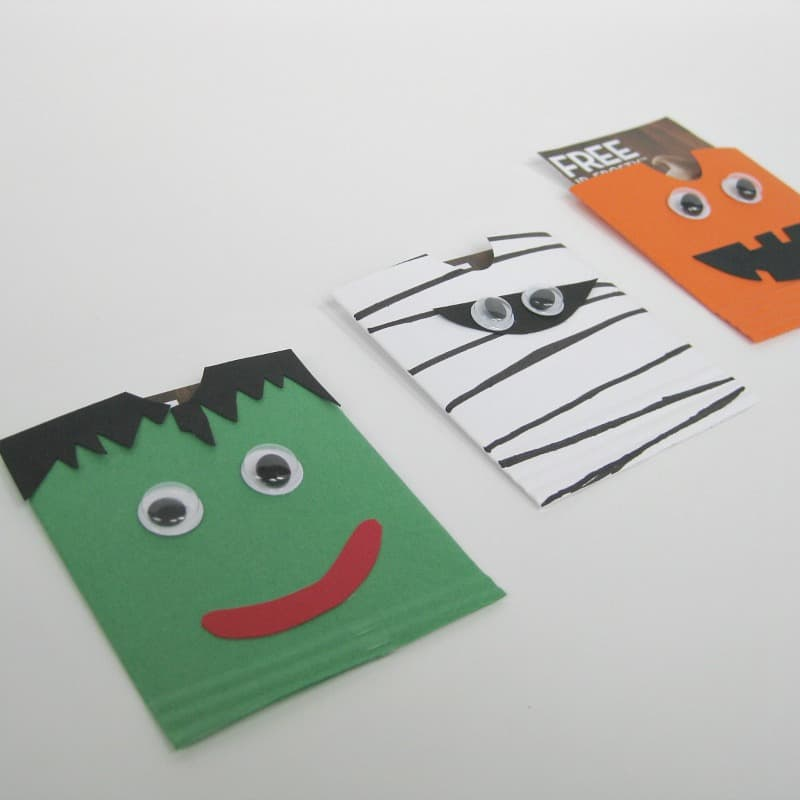 close up of 3 DIY envelopes decorated to look like a mummy, a monster and a jack o'lantern