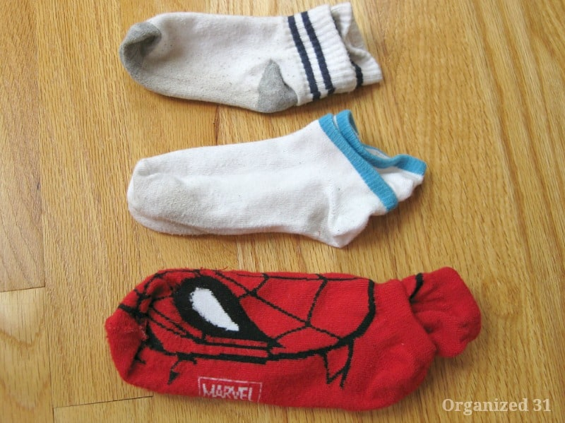3 pairs of socks with one tucked inside the other