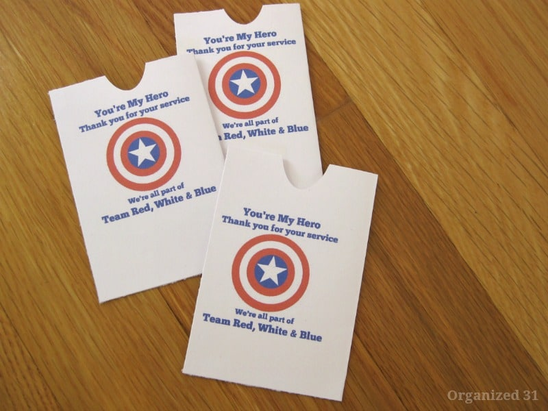 """3 small white DIY envelopes with red, white and blue star design and """"You're My Hero"""" text"""