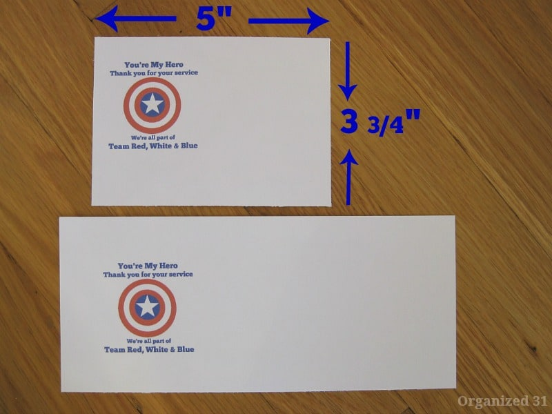 2 pieces of paper with red, white and blue design and arrows showing measurements