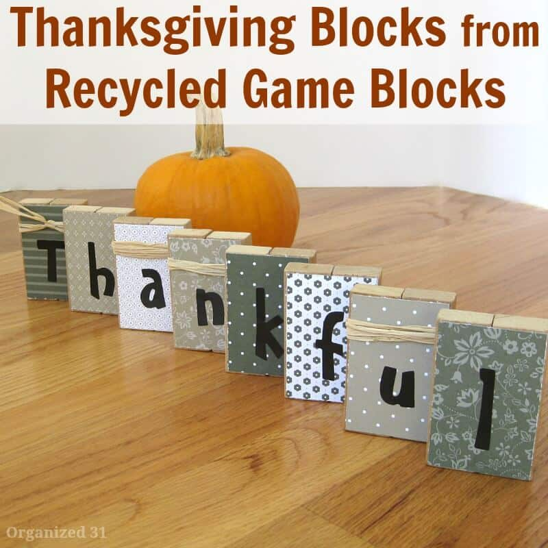 decorated blocks spelling thankful and pumpkin on table