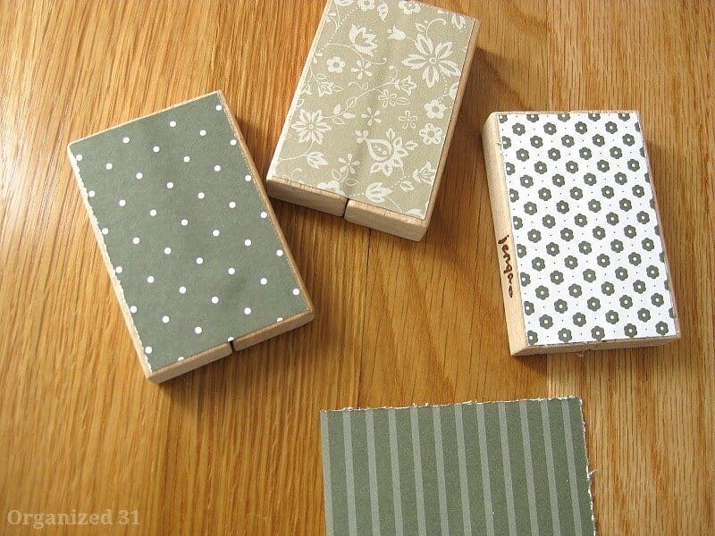 blocks with decorative paper on wood table