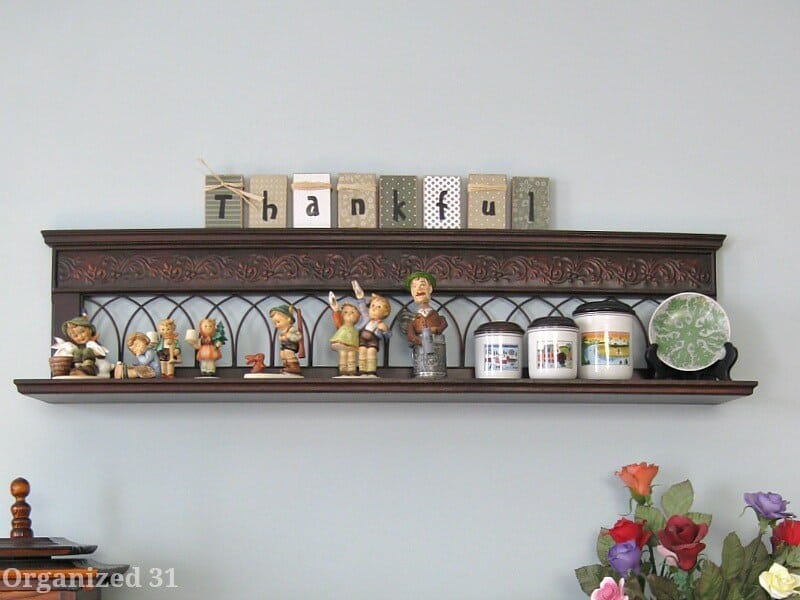 shelf with knick knacks and blocks spelling thankful
