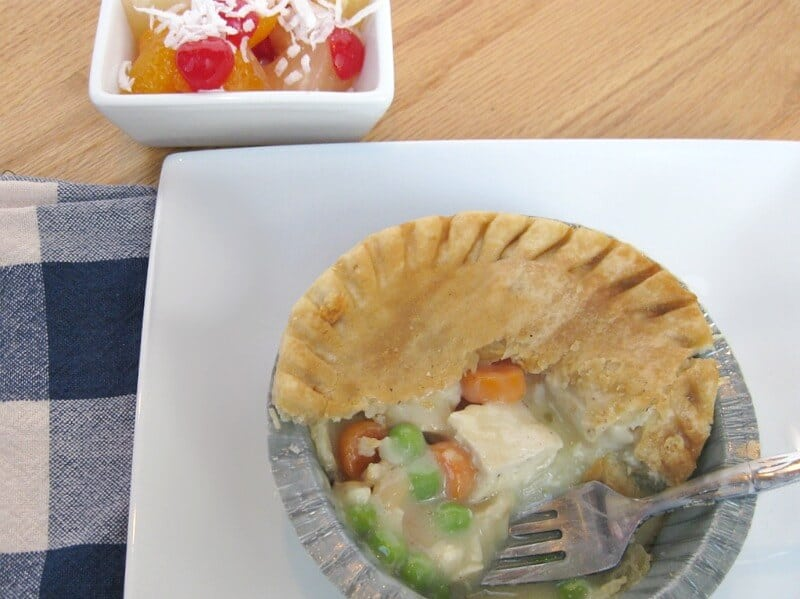 fork in partially eaten pot pie on white plate