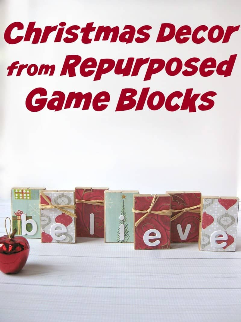 """blocks decorated with Christmas paper that spell out """"believe"""""""