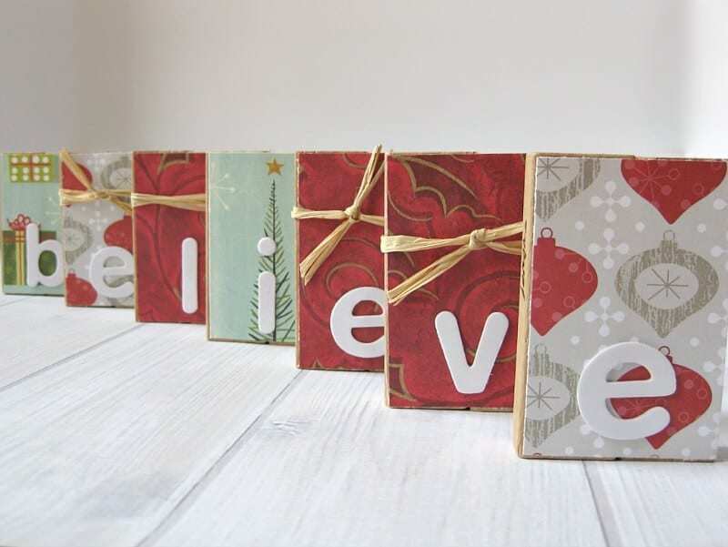 """close up of decorated blocks that spell out """"believe"""""""