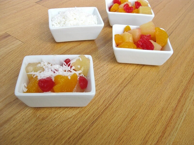 small bowls of fruit salad and coconut
