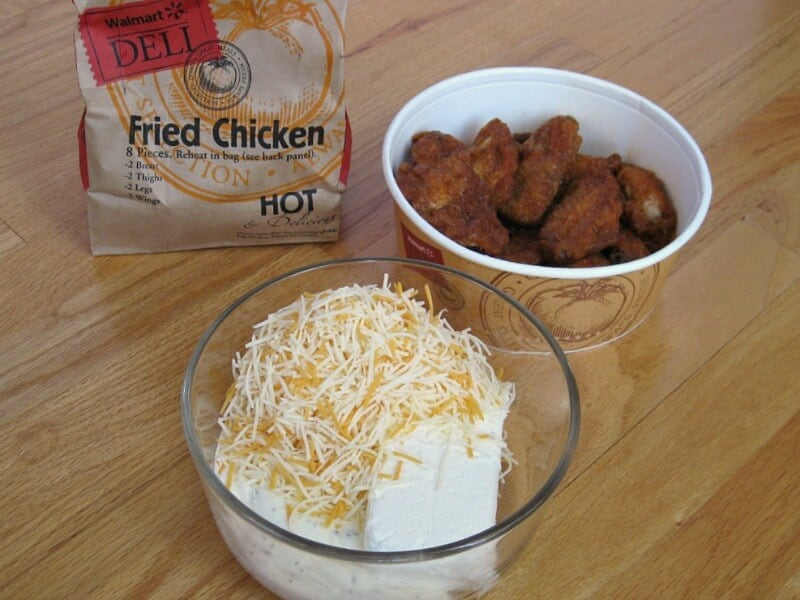 bag of fried chicken, bowl of chicken and clear bowl with cheese