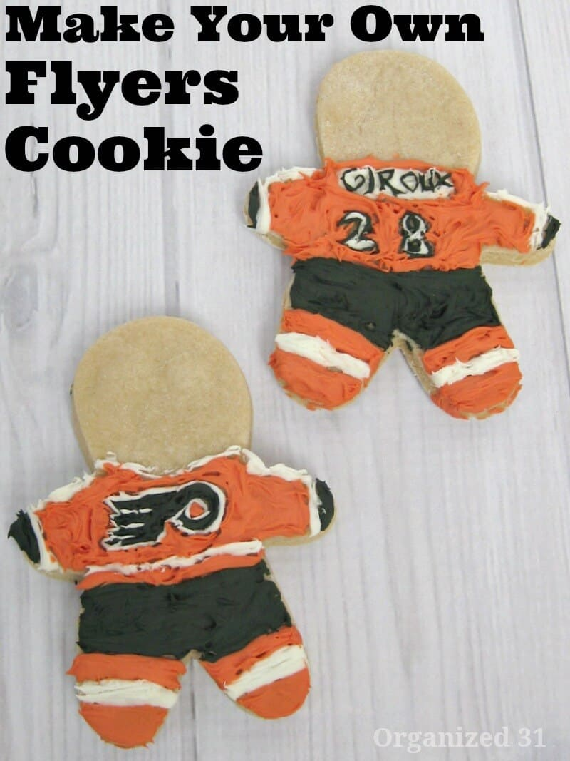 2 hand frosted cookies to look like Philadelphia Flyer players
